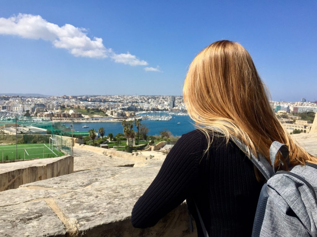 Woman who watch the sea of malta with long hair